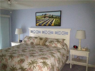 Fantastic 2/BR, 2 BA Pool VIew Condo Near Everything Vacation Rental MASTER KING BEDROOM WITH SLIDERS TO LANAI