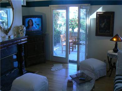Huntington Seaside Villa - Surf City USA Vacation Rental Living Room with French Doors