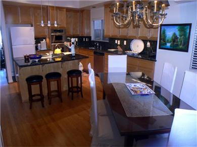 Huntington Seaside Villa - Surf City USA Vacation Rental Kitchen and Dining Area