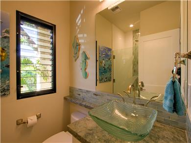 Wailea Elua Village Condo Vacation Rental Guest bathroom has shower, etched door