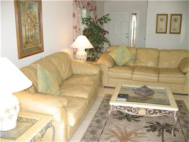VIP VILLA, Luxury lakeside villa close to Disney Vacation Rental Leather sofas in sitting room