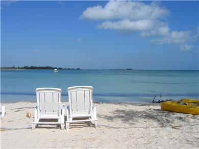 OCEANFRONT 3br  HOUSE SECLUDED SANDY BEACH, ANDROS BAHAMAS Vacation Rental Beach Chairs on Beach in Front of House