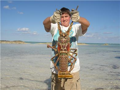 OCEANFRONT 3br  HOUSE SECLUDED SANDY BEACH, ANDROS BAHAMAS Vacation Rental Our son Dylan w/catch of the day!