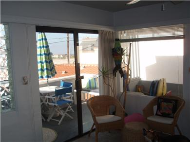 The Sun Catchers ~ Above the Crowd and At The Beach Vacation Rental More living room to deck; dining area to kitchen.