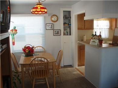 The Sun Catchers ~ Above the Crowd and At The Beach Vacation Rental Open counter to kitchen; note gift basket.