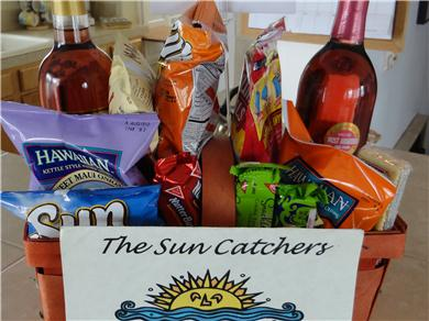 The Sun Catchers ~ Above the Crowd and At The Beach Vacation Rental Coodie Basket of salty & sweet treats.
