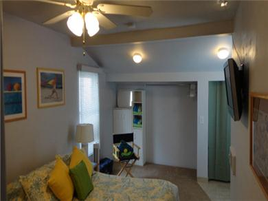 The Sun Catchers ~ Above the Crowd and At The Beach Vacation Rental Queen bed, TV, chair,room for PacnPlay.
