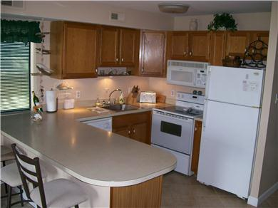 Jamacia IV Condo on 56th St - Romantic Bayside Getaway Vacation Rental Kitchen