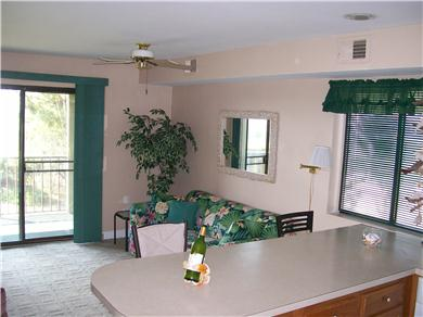 Jamacia IV Condo on 56th St - Romantic Bayside Getaway Vacation Rental Living Room view from kitchen
