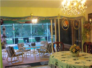 BEAUTIFUL HOUSE FENCED ON 2 ACRES WITH POOL AND PLAYROOM Vacation Rental dining room looking out to fl room and pool